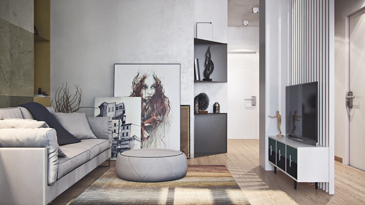 Wispy-framed-portraits-light-grey-couches-nineties-living-room